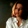 amalnahurriyeh: Dana Scully in a man's white dress shirt, looking annoyed and super hot. (scully hot)
