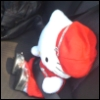 ambersweet: Plushie Hello Kitty buckled into the car. (On the go!)