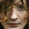 signifier: a woman in closeup with curly hair (Ourfa: Muri (Wife and Witch))