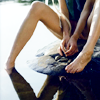 kitefullofkoi: picture of a woman sitting on a wet floor with bare legs (blue)