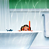 mokie: A girl in a bathtub wearing a snorkel (hair, soap, bathtime, waiting)