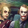 mokie: The Dark Knight's Joker inserted into a scene from Beetlejuice (giggly, confused, mwahahaha, curious, mischievous)