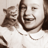 mokie: A vintage image of a girl and kitten smiling (pets)