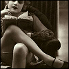 mokie: Vintage photo of a woman with legs crossed reading a book (smart)