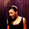 laceblade: Santana singing on stage in a black dress, facial expression almost painful (Glee: Santana RHI)