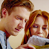 such_heights: amy and rory looking at a pile of post (who: amy [tardis light])