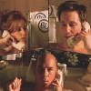 sharpest_asp: The trio are all on the phones in their separate baths (X-Files: Scully Mulder Skinner)