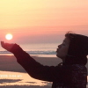 carrieann: cupped hands holding sunset (holding the sun)
