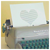 pipisafoat: a typewriter with a sheet of paper sticking out of it with a large heart on it (hot shit yay)