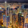 quillori: photo of a city at night (subject: city (night), theme: civilisation (urban), theme: cities)