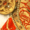 quillori: detail of rich robes with jewelled ornaments (theme: luxury (treasure))