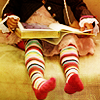fish_echo: Photo of a girl in rainbow kneesocks reading a book held on her lap (Misc-rainbow socks reading a book)