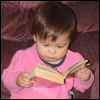"kate_nepveu: toddler ""reading"" paperback book (SteelyKid - reading (2010-04))"