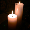 ckd: two white candles on a dark background (candles)