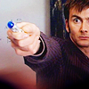 tomato564: David Tennant as the Doctor with his sonic screwdriver. (Doctor Who)