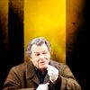 randomling: Walter Bishop (Fringe) grins, eating something. (happy)