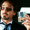 randomling: Tony Stark, in sunglasses, waves his whisky glass around. (tony stark)