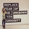 "delight: girl with camera; text ""replace fear of the unknown with curiosity"" (see you later innovator)"