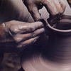 tiamatschild: A photograph of a pair of hands shaping a pot on a pottery wheel (Making something new)