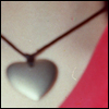 thecolourclear: bit of neck and red shirt with silver heart necklace on black cord (love: necklace)