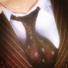 oulfis: Close up of Dr. Who: white collar, brown dotted tie, lapels of a brown striped suit jacket, just a bit of neck. (tie, dr. who)