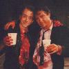 delphi: Tim Roth and Harvey Keitel, bloodied, with their arms around each other on the set of Reservoir Dogs. (Orange/White)