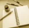 faerie_dreamer: an open book & writing utencils, a blank page ready for all the creativity you can pour into it (writing)