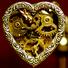 actionreaction: photo of a heart, steampunk style, made with cogs and gears ([steampunk] clockwork heart)