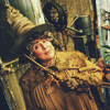 cranky_x_crocus: The character Pomona Sprout, short and sturdy, grinning with her near her face. (HP || Pomona || Herbology wand.)