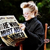 cranky_x_crocus: Character Minerva McGonagall with a loose bun, sitting in a wheelchair and reading a paper about Voldemort. (HP || McMin || Wheelchair paper.)