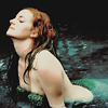 cranky_x_crocus: A serene water nymph/mermaid in the water with her back arched and head back, wearing a green bra. (Women || Water nyph.)