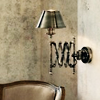 nightdog_barks: An accordian-flex wall lamp extends over the back of a chair (Wall Lamp)