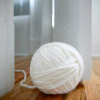 hark: a ball of white wool, sneaking round the door (white wool)