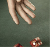 godplaysdice: A hand rolls a pair of red dice (Default)