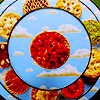 aberration: Fruit pies arranged on a rising set of circular shelves. (warm and safe and)