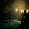 mistressofmuses: A man is seated, facing a broken fence. The image is dark, with bright points of candlelight in the background. (horror)