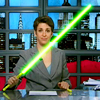 sarken: rachel maddow wielding a green lightsaber ([pundits] makes a lightsaber)