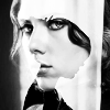 rhi: Natasha in black and white. face on in front of pic, profile in background (Natasha)