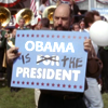 "kshandra: Toby Ziegler, marker in hand, holding a sign that has been doctored to read ""Obama f/o/r IS THE President"" (West Wing Obama)"