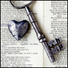 smittywing: Metal heart and key on an open book. (Heart/Key OTP)
