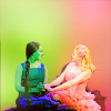 mercredigirl: Screencap from Wicked in green and pink tones: Galinda (Kristin Chenoweth) holding Elphaba's (Idina Menzel) hands. (Wicked friendship)