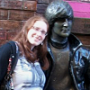 mercuryzelda: Photo of me standing next to a John Lennon statue in Liverpool. (Default)