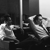 omens: Behind the scenes photo of Gabriel and Patrick in Harvey's condo. (SUITS - b&w lawyers)