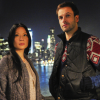beatrice_otter: Joan and Sherlock in front of New York city at night (Elementary)