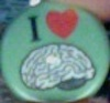 firecat: button with the letter I, a heart symbol, and a human brain graphic (i heart brains)