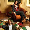 scintilla10: Joan sits in a chair; Sherlock lies at her feet surrounded by books (Elementary - Joan is clearly the alpha)