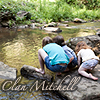 cesy: Kids playing by a stream (Clan Mitchell)