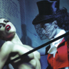 st_aurafina: A woman in a top hat and veil dominating another woman (Kink: top hat)