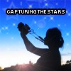 "jesse_the_k: Woman holds camera overhead, captioned ""capturing the stars"" (photographer at work)"