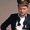"nanaya: ""A photograph of Charlie Brooker in a scruffy tux, wearing a military cap"" (cap)"